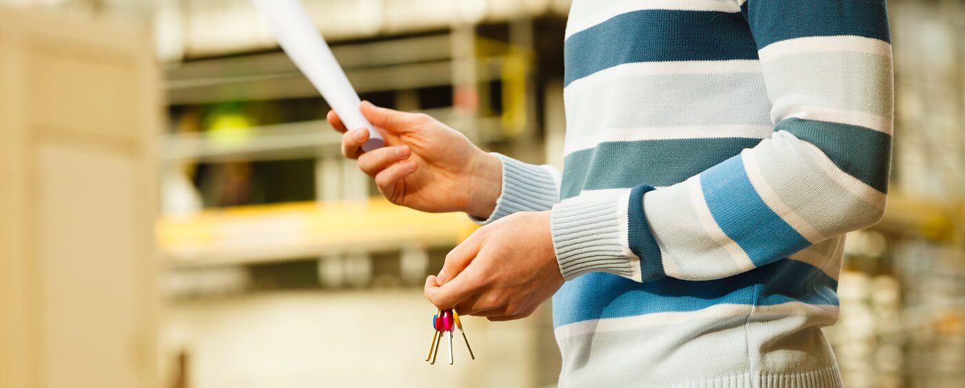 men holding rental agreement and keys